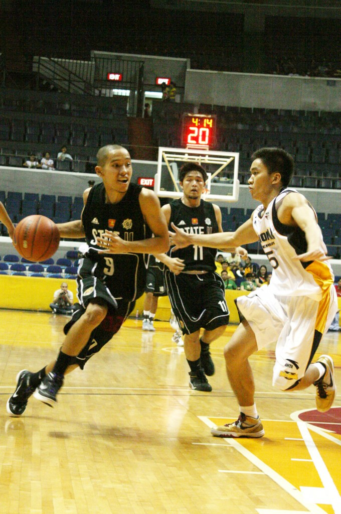 UP Fighting Maroons rookie Mikee Reyes charges towards Micheal Luy of the NU Bulldogs as Mike Maniego looks on during the two teams' second meeting at the UAAP Season 72 Men's Basketball division. Photo by Roehl Niño Bautista