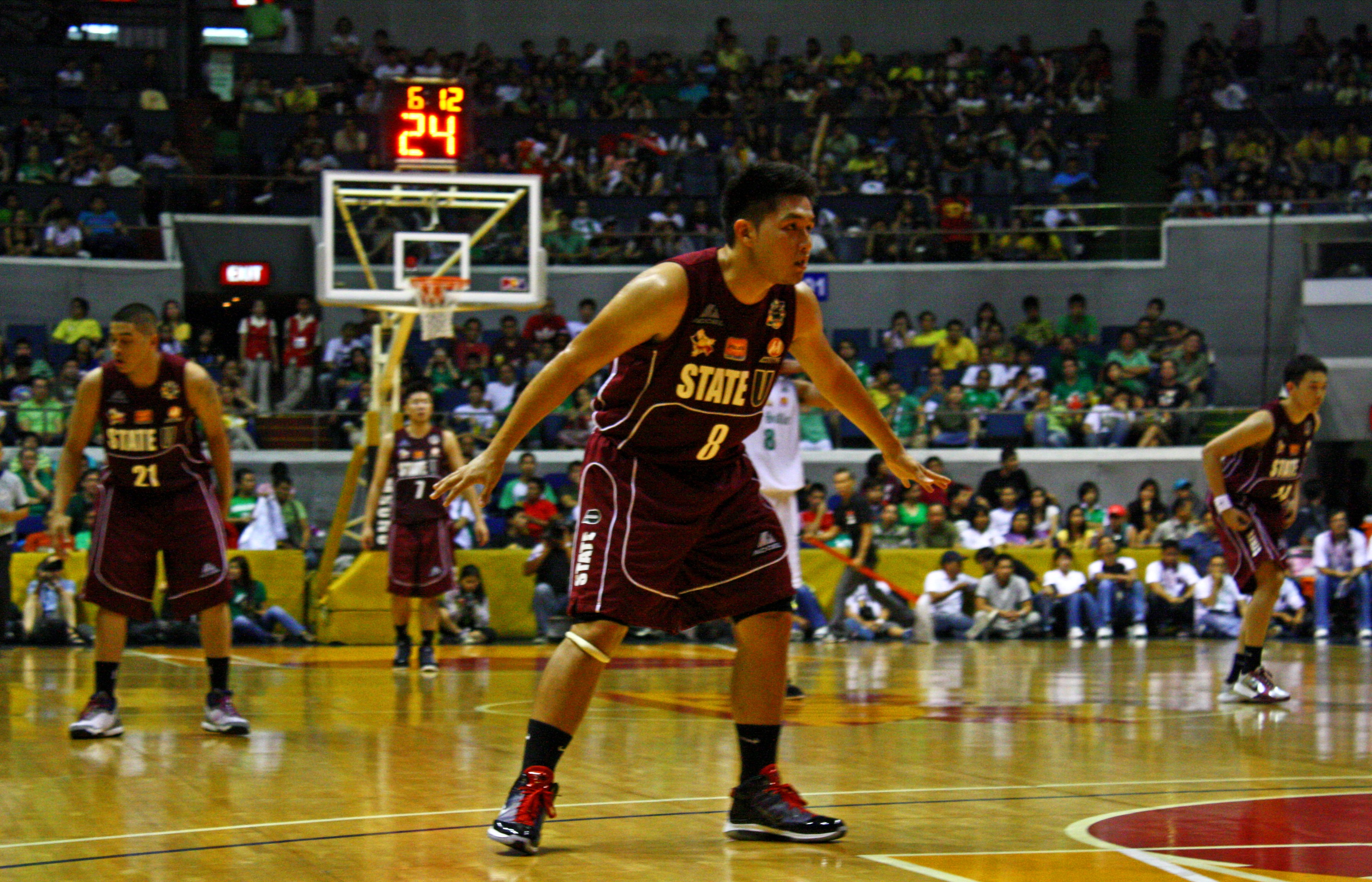 Atkins leads Archers past Maroons, 80-62